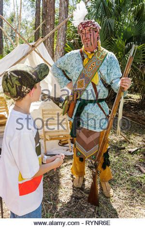 Native North American Indian boy in war paint & feathers