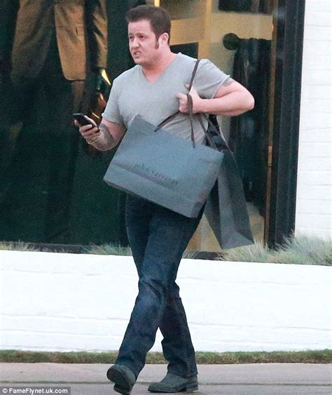 Chaz Bono looks spruced up after a visit to The Proper