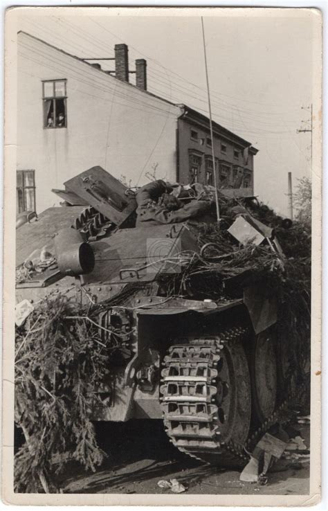 A knocked out Hetzer with the body of one of it's crew